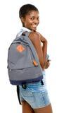 Lyckad afrikansk amerikanstudentkvinna som tillbaka går till skola I Arkivbild