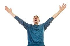 Lyckad knatte för lycklig man med armar upp royaltyfri fotografi