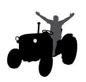 Lyckad lycklig bonde på traktoren med händer upp Royaltyfri Foto