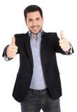 Lyckad lycklig isolerad ung affärsman med tummar upp Arkivfoto