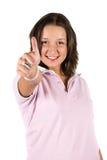 Lyckad tonåring med tumen upp Fotografering för Bildbyråer