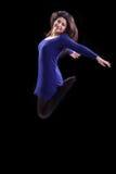 Lyckad ung kvinna som hoppar upp Royaltyfria Bilder