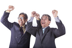 Lyckade lyckasinnesrörelsepar av asiatisk hög affärsmor Royaltyfri Foto