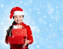 Lyckaflicka med gåvor Arkivfoton