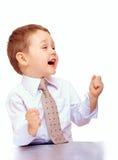 Lyckat affärsbarn som uttrycker positivity royaltyfri bild
