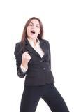 Lyckat agera för affärskvinna som är entusiastiskt som en vinnare Arkivbild