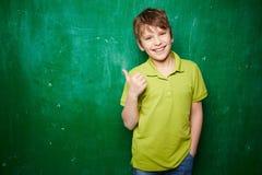 Lyckat skolbarn Fotografering för Bildbyråer