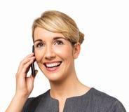 Lycklig affärskvinna Answering Smart Phone Royaltyfria Bilder