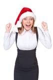 Lycklig affärskvinna, i att ropa för santa hatt av glädje Arkivfoto