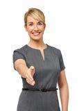 Lycklig affärskvinna Offering Handshake Royaltyfri Fotografi