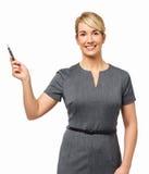 Lycklig affärskvinna Pointing With Pen Arkivfoto