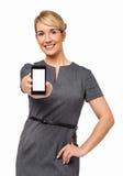Lycklig affärskvinna Showing Smart Phone Arkivbild