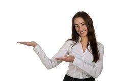 Lycklig affärskvinna som framlägger något Fotografering för Bildbyråer