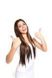 Lycklig affärskvinna som ger två tummar upp på vit bakgrund Royaltyfria Bilder