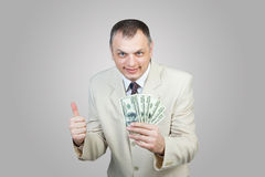 Lycklig affärsman med pengar Arkivfoton