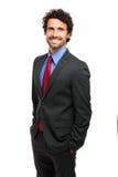 Lycklig affärsman på vit bakgrund arkivfoton