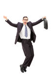 Lycklig affärsman som dansar Arkivbild
