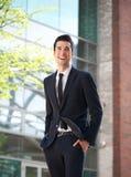 Lycklig affärsman som går för att arbeta Fotografering för Bildbyråer