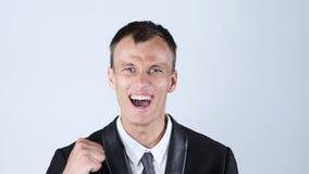 Lycklig affärsman som tycker om framgången som har after goda nyheter Fotografering för Bildbyråer
