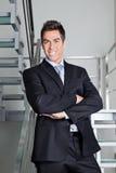 Lycklig affärsman Standing On Stairs fotografering för bildbyråer