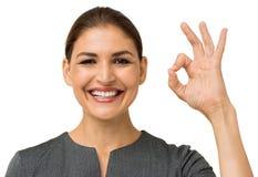 Lycklig affärskvinna Gesturing Okay Arkivfoton