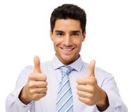 Lycklig affärsman Gesturing Thumbs Up Royaltyfri Foto