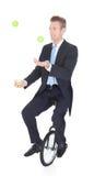 Lycklig affärsman Juggling Royaltyfri Foto