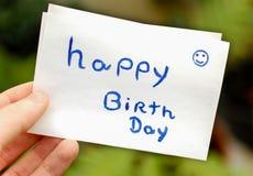 Lycklig anmärkning för födelsedagpapper Arkivfoto