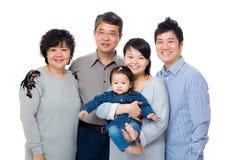Lycklig asiatfamilj för tre utveckling royaltyfria foton