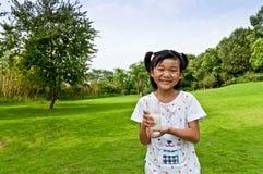 Lycklig asiatisk flicka Fotografering för Bildbyråer