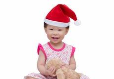 Lycklig asiatisk flicka med julhatten Royaltyfria Foton