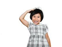 Lycklig asiatisk flicka som skrapar hennes huvud Arkivfoto