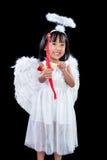 Lycklig asiatisk kinesisk liten ängel med pilbåge och pil Fotografering för Bildbyråer
