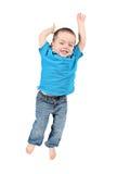 lycklig banhoppningförträning för pojke Arkivbilder