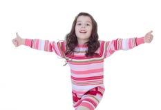 Lycklig barnflicka med handtummar upp Royaltyfria Foton