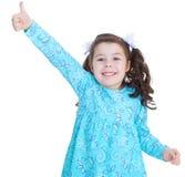 Lycklig barnflicka med handtummar upp Arkivfoto