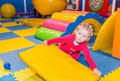 Lycklig barnflicka på lekplats Fotografering för Bildbyråer