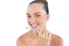 Lycklig barnmodell med tandborsten Fotografering för Bildbyråer