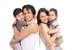 Lycklig blandras- familj av fyra royaltyfria bilder