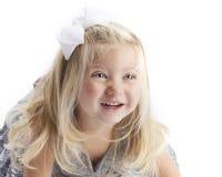 Lycklig blond flickavitbakgrund royaltyfri foto