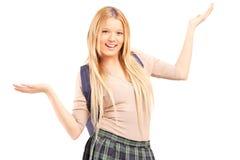 Lycklig blond kvinnlig student med lyftta händer Royaltyfria Foton