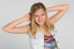 Lycklig blond tonårig flicka Arkivbild