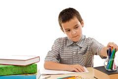lycklig blyertspennaschoolboytake royaltyfri bild