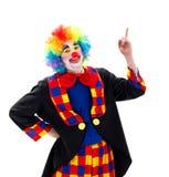 Lycklig clown som uppåt pekar royaltyfri bild