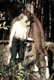 Lycklig cowgirl med henne tonad röd horse.art Fotografering för Bildbyråer