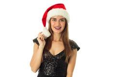Lycklig cutieflicka i den santa hatten Arkivfoto