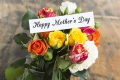 Lycklig dag för moder` s hälsningkort, med buketten av Multicolore Fotografering för Bildbyråer