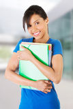 Lycklig deltagarekvinna med anteckningsböcker Fotografering för Bildbyråer