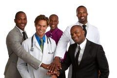 Lycklig doktor och lag av affärsmän alla händer in Arkivfoto