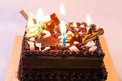 Lycklig födelsedag för kakachoklad på asken Arkivbilder